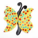 a cut paper plate forming butterfly wings