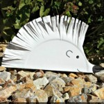 a spiky hedgehog made from kids cutting paper plates