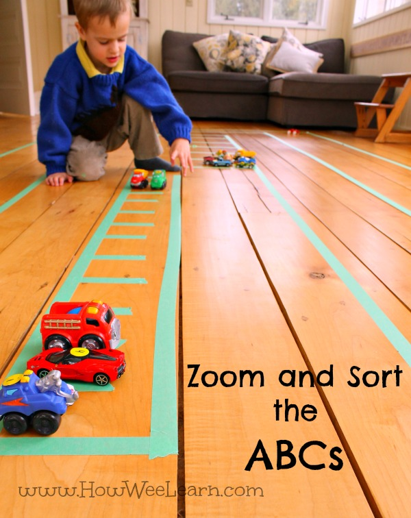 playing with cars and racing to sort the letters is a fun way to practice the abc's!