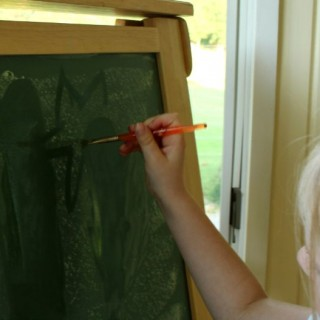 painting with water on chalk is a great mess free activity!