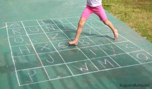 Learning the alphabet this summer - abc chalk game