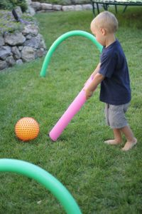 Summer games to play outside - pool noodle hockey