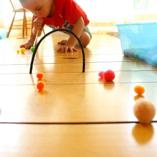 This is a fabulous quiet time activity for preschoolers and toddlers! Pompom hockey using a straw for blowing. So many awesome quiet bins idea on this site.