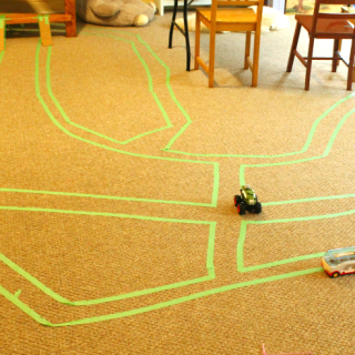Use painters tape to make roads, maps, and mazes on the ground for preschoolers! Perfect quiet time activities.