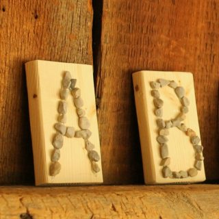 Use pebbles to make a beautiful tactile alphabet. A great way to practice letters and letter formation and the ABCs!