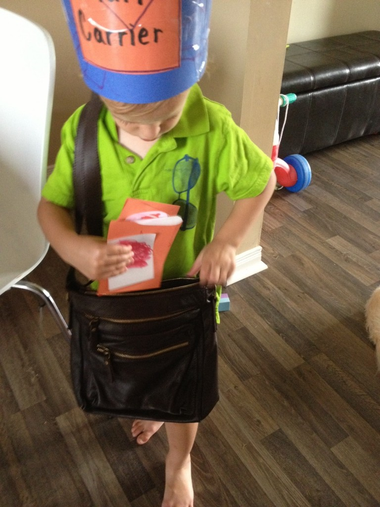 Our preschool mail carrier used a purse to carry his letters to their mailboxes.