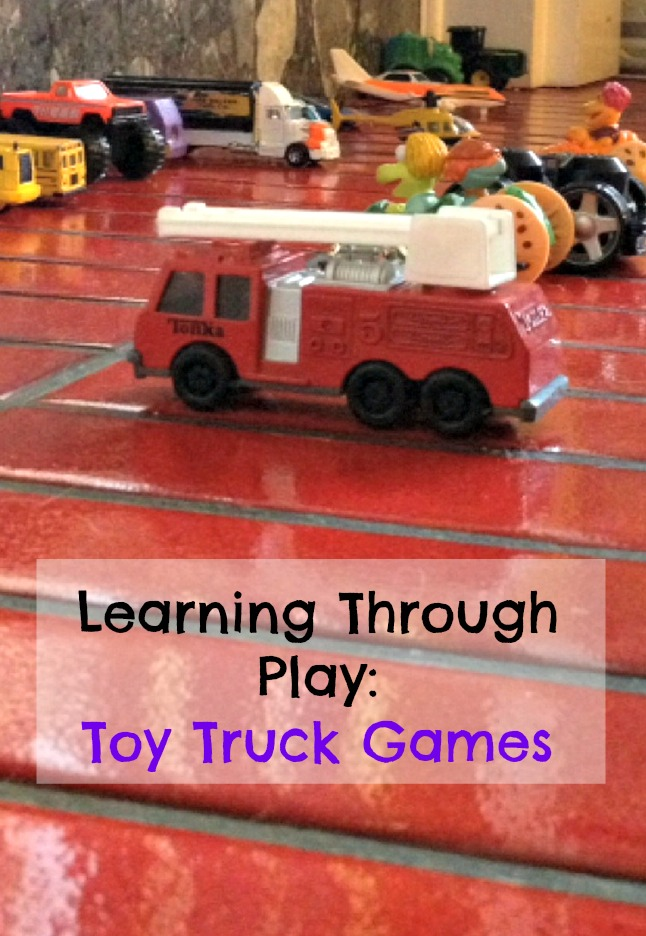 playing with toy trucks