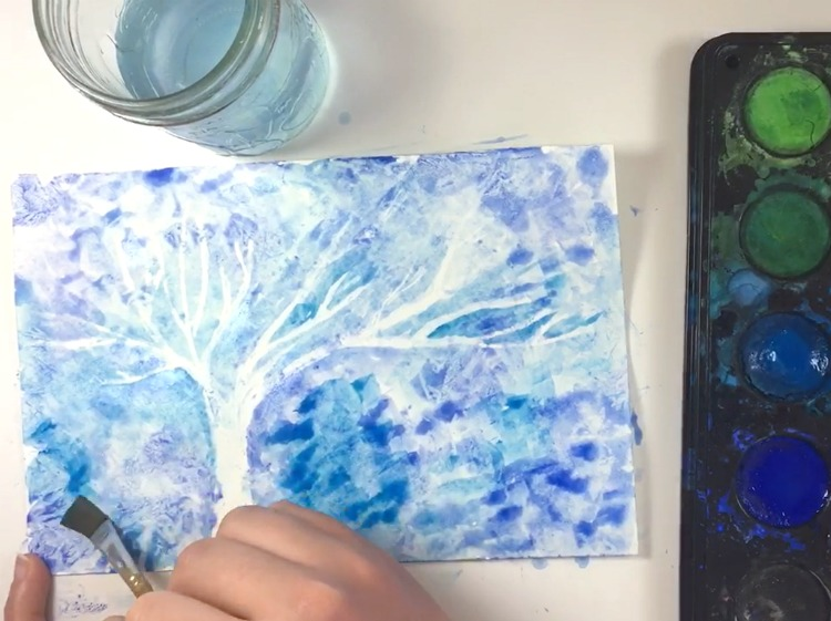 This winter art project for kids is so easy and BEAUTIFUL! Make a winter tree using white crayon and paint! A great winter craft for preschoolers and kids of ALL ages! #HowWeeLearndotcom #winterart #artprojectsforkids #crayonresist #paintingideas #watercolor #kidscrafts #artsandcrafts #artsandcraftsforkids