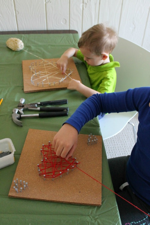 Such a fun art activity for preschoolers - string heart art! Perfect for Valentines Day! Love this Valentines craft. #valentinesday #valentines #artactivity #preschool #craft