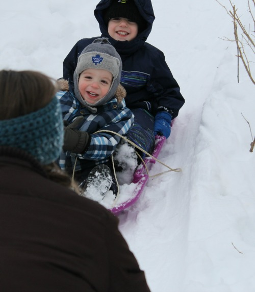 how we learn sledding down a hill during a nature walk