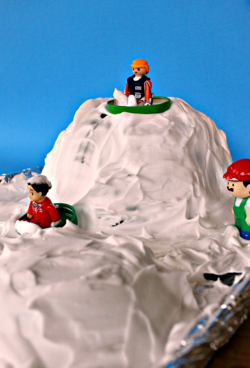 Sensory Activities for Toddlers - Use shaving cream to create a pretend winter wonderland with figurines and toys
