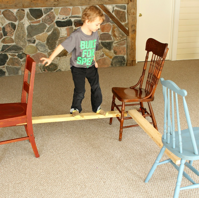 Balancing beam for preschoolers using chairs and 2 x 4's