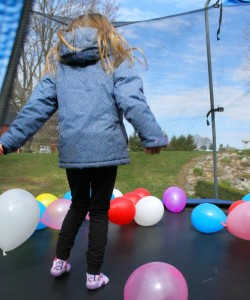 Balloons on the trampoline -a perfect brithday party idea!