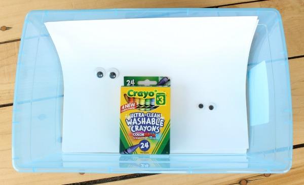 A creative quiet bin for kids to colour around googly eyes