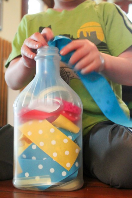 Quiet activities for toddlers - ribbons into a jar