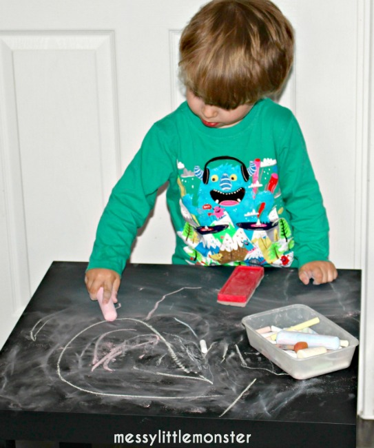 Quiet activities for two year olds - drawing on a chalk table