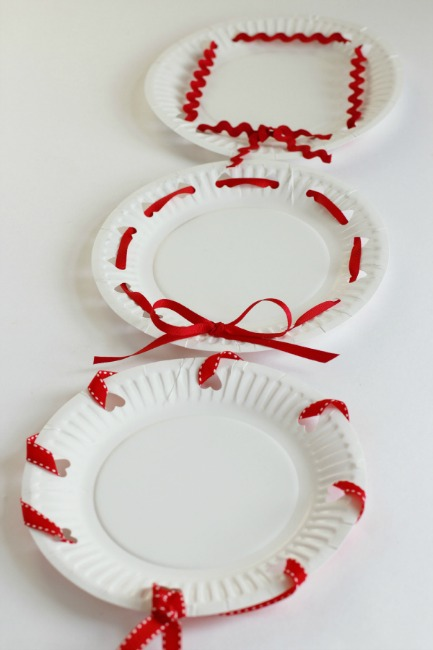 Paper plate valentine crafts - hole punched plates
