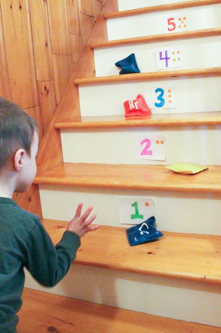 Learn numbers on the stairs with a bean bag toss!