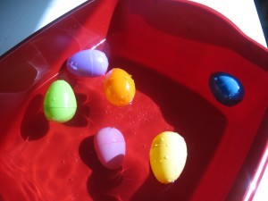 Preschool Easter activities - sink and float with plastic eggs