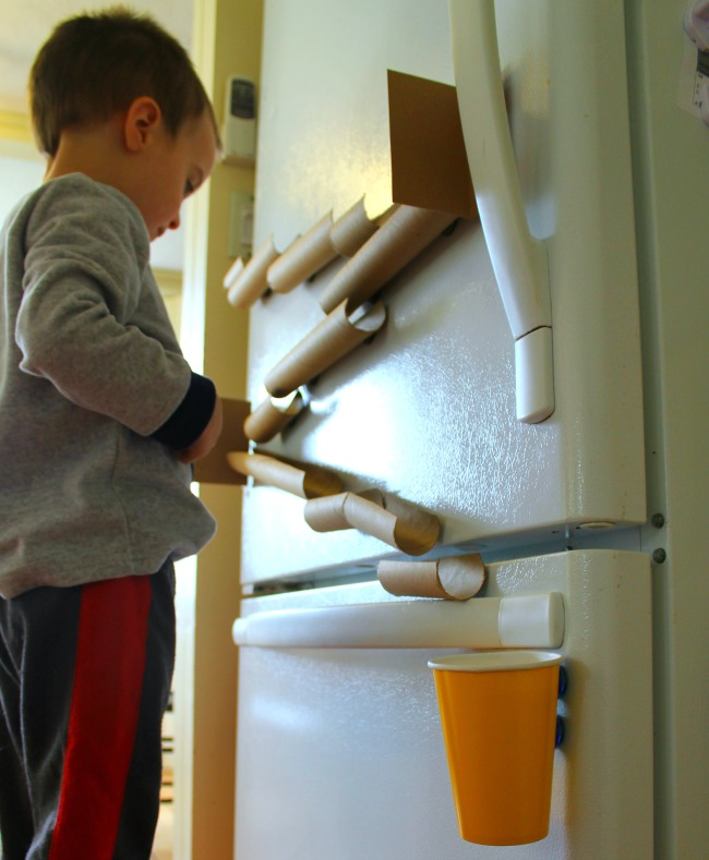 A magnetic marble run perfect for quiet time! Paper towel tubes and magnets