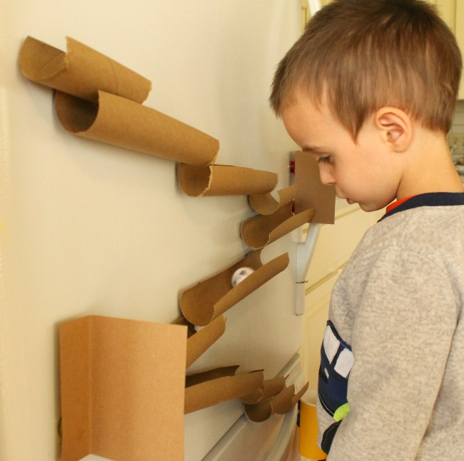 A magnetic marble run perfect for the fridge! Paper towel tubes and some magnets