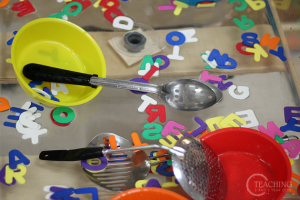 Learning the alphabet this summer - alphabet soup sensory play