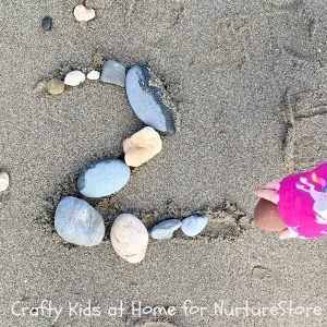 number summer learning - rock numbers on the beach
