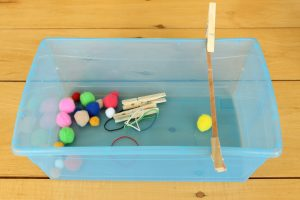 This is a great science activity for little ones - and it's and independent quiet bin! Plus it involves a slingshot and pompoms, so the kids LOVE it.