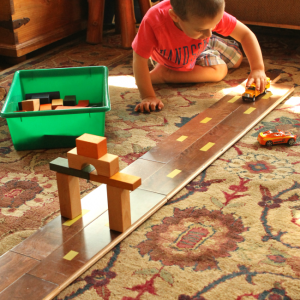 Using laminate flooring as a road! Brilliant DIY toy for preschoolers