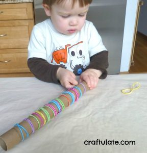 fine-motor-activities-hair-ties-and-carboard-tubes