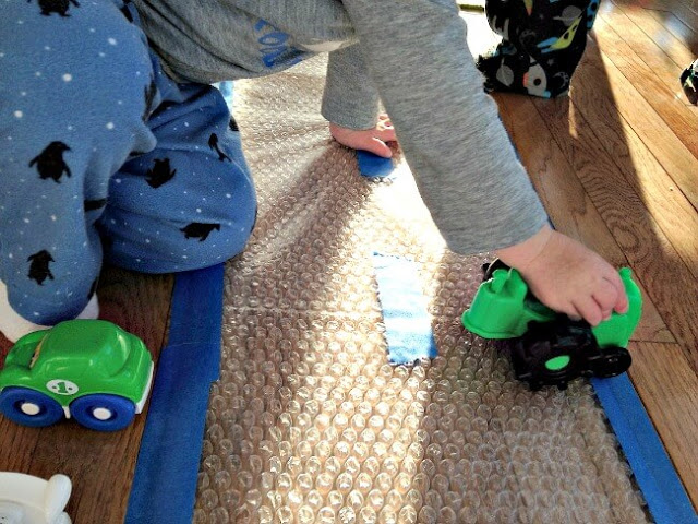 Sensory Activities for Toddlers - create a bubble wrap road for cars and trucks to add a sensory experience to imaginative play