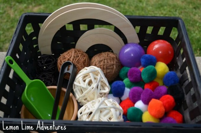 Sensory Activities for Toddlers - Circles of many sizes and textures are placed in a box to promote learning and exploration