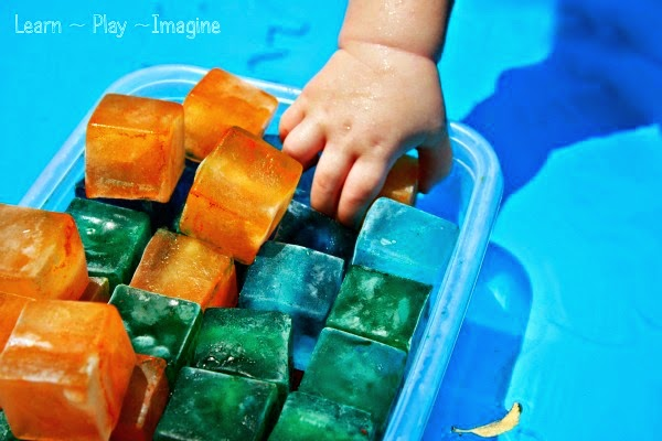 Sensory Activities for Toddlers - Learn about warm and cold with colored ice cubes that slip and slide and melt away, using many senses for this activity