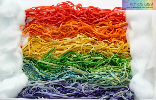 Sensory Activities for Toddlers - a sensory box great for tactile play using colorful rainbow pasta and soap foam for clouds