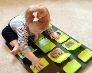 Sensory Activities for Toddlers - Use plastic lids from diaper wipes to reveal every day items or many textures for baby and toddler to explore