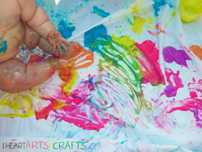 Sensory Activities for Toddlers - Adding neon food-coloring to yogurt creates edible paint for squishy and creative sensory play
