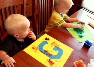 finger-painting-ideas-tape-resist-letters