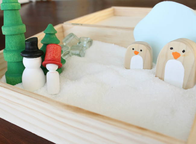 A gorgeous sensory bin idea for preschoolers! Such beautiful wooden toys for kids with pretend snow too!