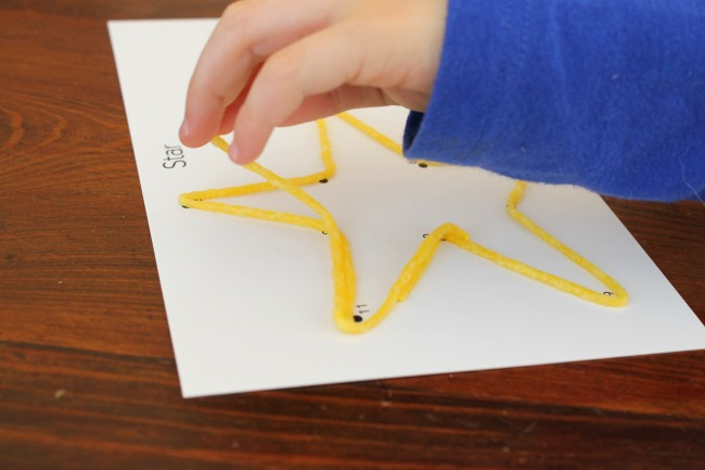 Playing with Wikki Stix! Great for fine motor development in preschoolers
