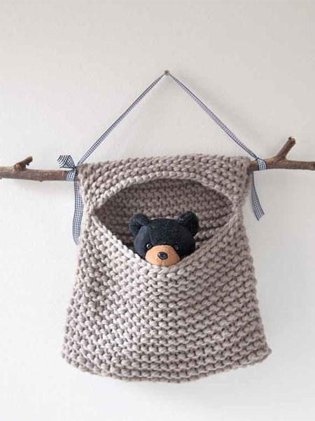 This toy hideaway bag is the perfect DIY for beginner knitters. It is such an easy knitting project made from only one knit square.