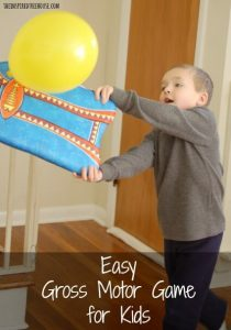 Crossing the Midline - Paddle balloon game