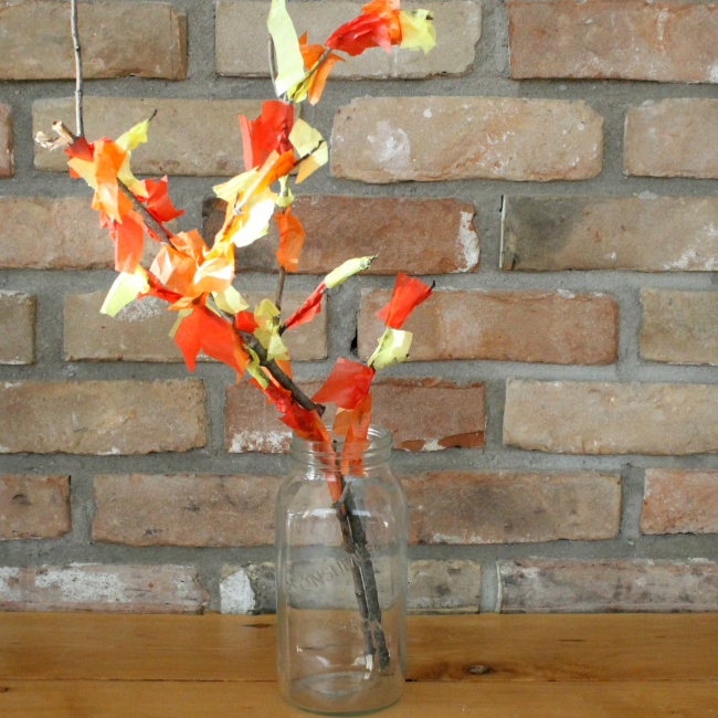 Use tissue paper to make a beautiful fall tree! Such a great sensory craft for preschoolers