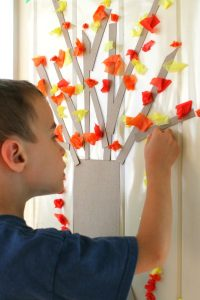 fabulous fall craft ideas for preschoolers - this contact paper tree is awesome for working on fine motor skills and such a cute craft for Autumn