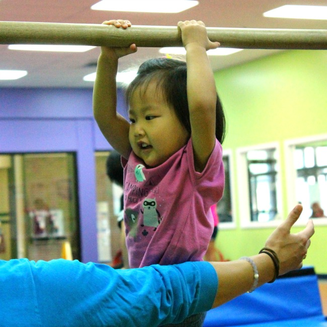 Twisting on the uneven bars - a fabulous activity for developing crossing the midline skills