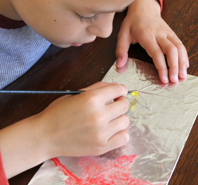 Using tin foil to make embossed tin leaves with kids this Fall!
