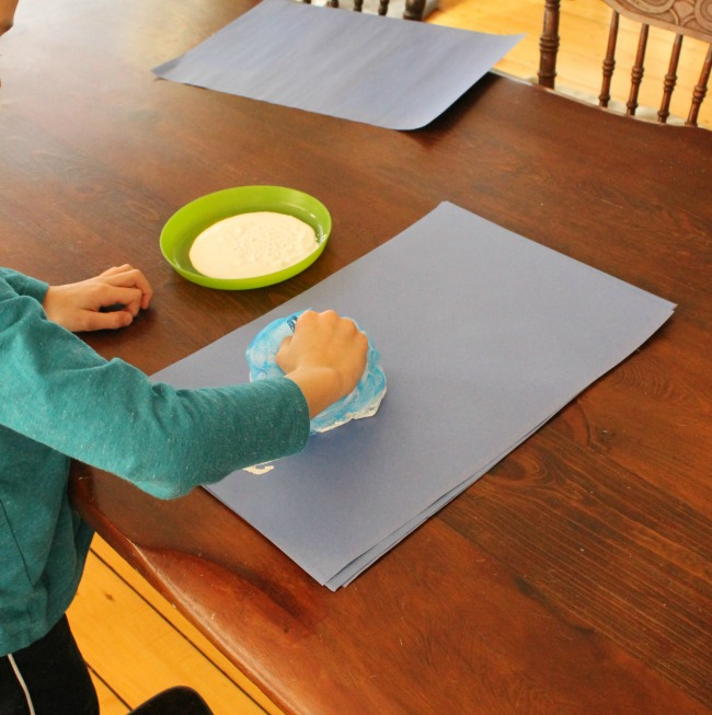 Making a snowman craft with a loofa -- perfect process art for preschoolers!