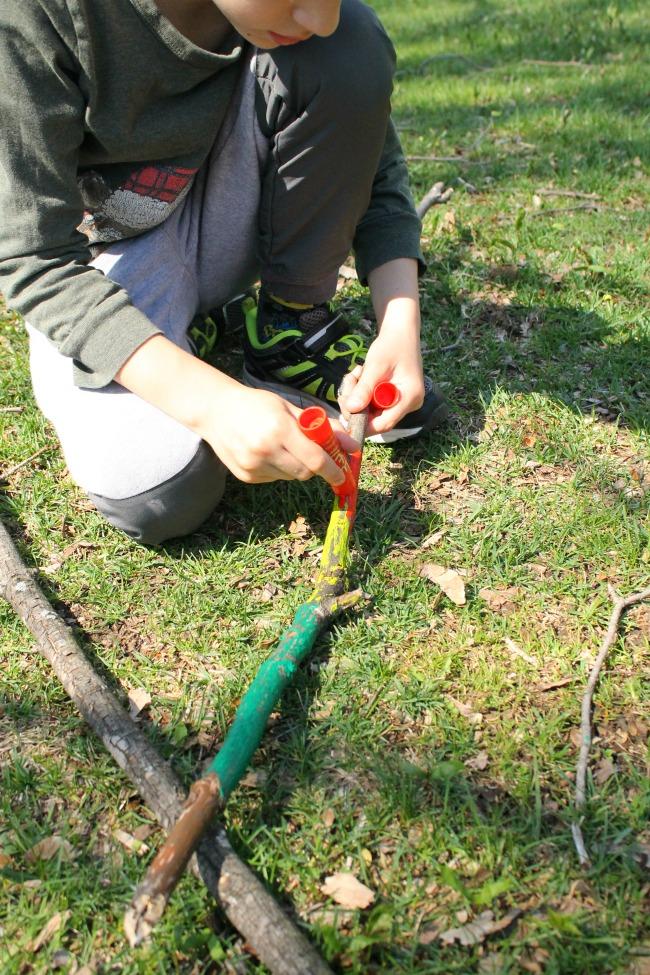 Creating walking sticks for our nature walks! A great preschool craft #sponsored #kwikstix #preschool #crafts #naturewalk #kidscrafts #naturecraft #outside #spring