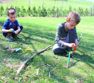 Creating walking sticks for our nature walks! A great preschool craft #sponsored #kwikstix #preschool #crafts #naturewalk #kidscrafts #naturecraft #outside #spring