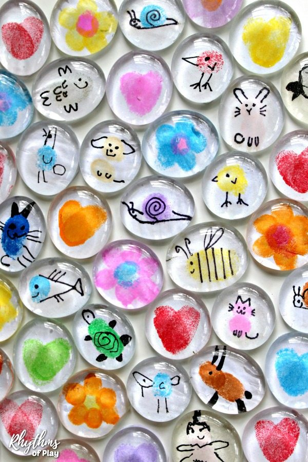 Use fingerprints on gems to make these great magnet crafts for kids
