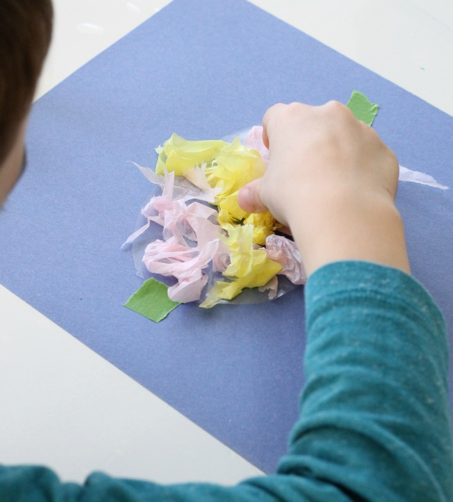 Sensory Activities for Toddlers - Using tissue paper to explore and make an Easter craft